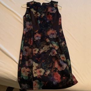 Floral dress with black netting overlay.